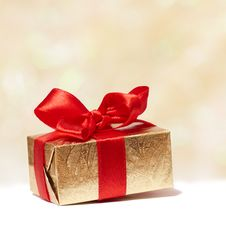 Free Gift Box With Red Bow On Blurred Background Stock Photo - 17312620
