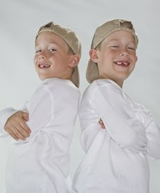 Free 6 Years Old Identical Twins Wearina A Baseball Hat Stock Photography - 17314852