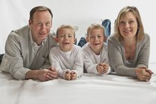 Young Happy Family With Two Identical Twins Stock Photo