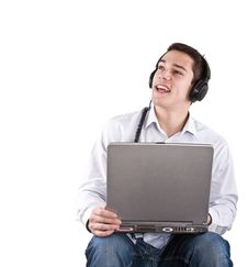 Free Enjoying Music From My Netbook Stock Photography - 17315742