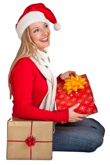 Woman In Santa Hat With Presents Royalty Free Stock Image