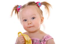 Free Little Girl Eats Banana Stock Photo - 17318360