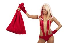 Woman In Santa Claus Suit With Gift Bag Stock Images