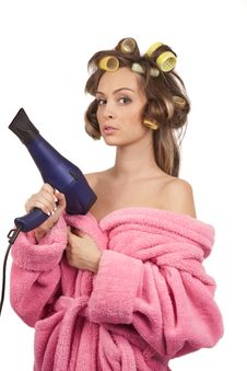 Free Girl In Pink Dressing Gown With Blue Hairdryer Royalty Free Stock Photography - 17318647