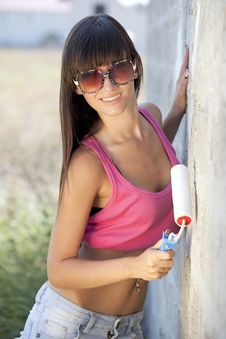 Young Woman Painting The Wall Royalty Free Stock Photo