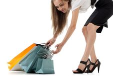 Free Stylish Woman Pulling Shopping Bags Stock Image - 17318701