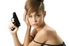 Free Young Woman With Handgun Royalty Free Stock Photography - 17318707
