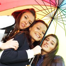 Free Smiling Girlfriends Under Umbrella Royalty Free Stock Photo - 17319125