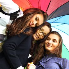 Free Smiling Girlfriends Under Umbrella Royalty Free Stock Photos - 17319138