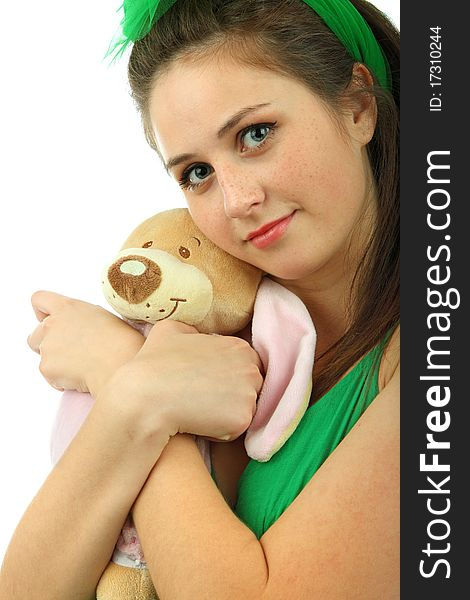 Portrait of the young girl with the teddy bear