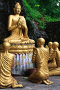 Free Gold Sitting Buddha Surrounded By Monk Students Royalty Free Stock Photos - 17322998