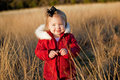 Free Small Girl In Red Jacket In A Field Royalty Free Stock Image - 17323456