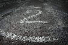 Number 2 Painted On Pavement Royalty Free Stock Images