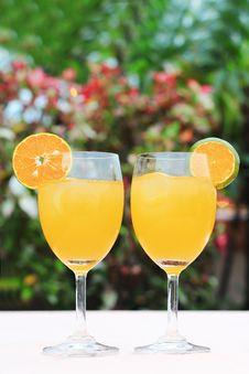 Free A Couple Glass Of Fresh Orange Juice Stock Photo - 17321880