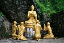 Gold Sitting Buddha Surrounded By Monk Students Stock Images