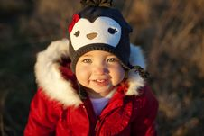 Cute Girl In Penguin Hat Smiling Stock Photo