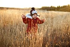 Free Cute Girl Running Through A Field At Sunset Royalty Free Stock Image - 17323496