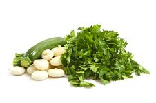 Zucchini, Onions And Parsley Stock Photos