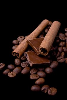 Free Cinnamon Sticks Over Coffee Beans And Chocolate Stock Photos - 17324033