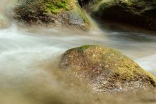 Boulders In The Stream Of Frothy Stock Images