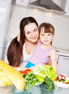 Mother And Daughter Cook Stock Photo