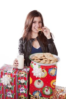 Eating Cookie Presents Stock Photo