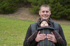 Father With Front Baby Carrier Royalty Free Stock Images