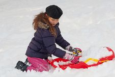 Girl With Toboggan In The Snow Stock Image