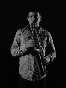 Young Handsome Man Playing Music On Saxophone Stock Photo