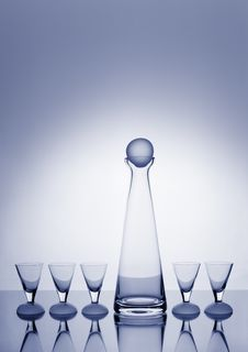 Free Decanter And Five Glasses Backlit And Blue-toned Royalty Free Stock Photos - 17337898