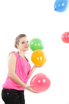 Girl Playing With Balloons Over White Royalty Free Stock Photos