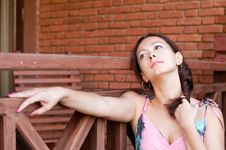 Free Dreaming Woman Near The Brick Wall Royalty Free Stock Photography - 17341237