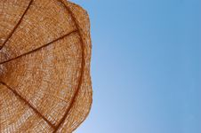 Sun Umbrella Against Sunny Sky Stock Image
