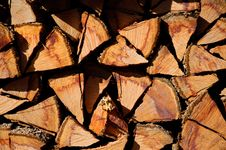 Stacked Logs Background Royalty Free Stock Photos
