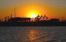Free Oil Pump Against Setting Sun Stock Photo - 17344800
