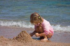 The Little Girl On Seacoast Royalty Free Stock Photos