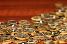 Golden Coins On A Wooden Table Royalty Free Stock Images