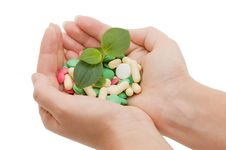 Free Hand With A Pill On White Royalty Free Stock Images - 17345329