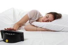 Woman In A Bed With Alarm Clock Stock Photo