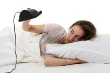 Woman In A Bed With Alarm Clock Stock Photos