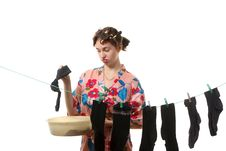 Free Housewife Hangs Up Socks On  The Clothesline Stock Photos - 17346663
