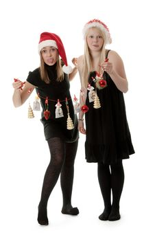 Two Girls In The Santa Hat Royalty Free Stock Images
