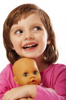 Happy Little Girl With Doll Stock Photography