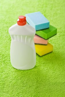 Bottle And Sponges On Green Towel Royalty Free Stock Image