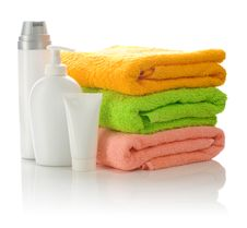 Bottles And Tube With Towels Stock Image