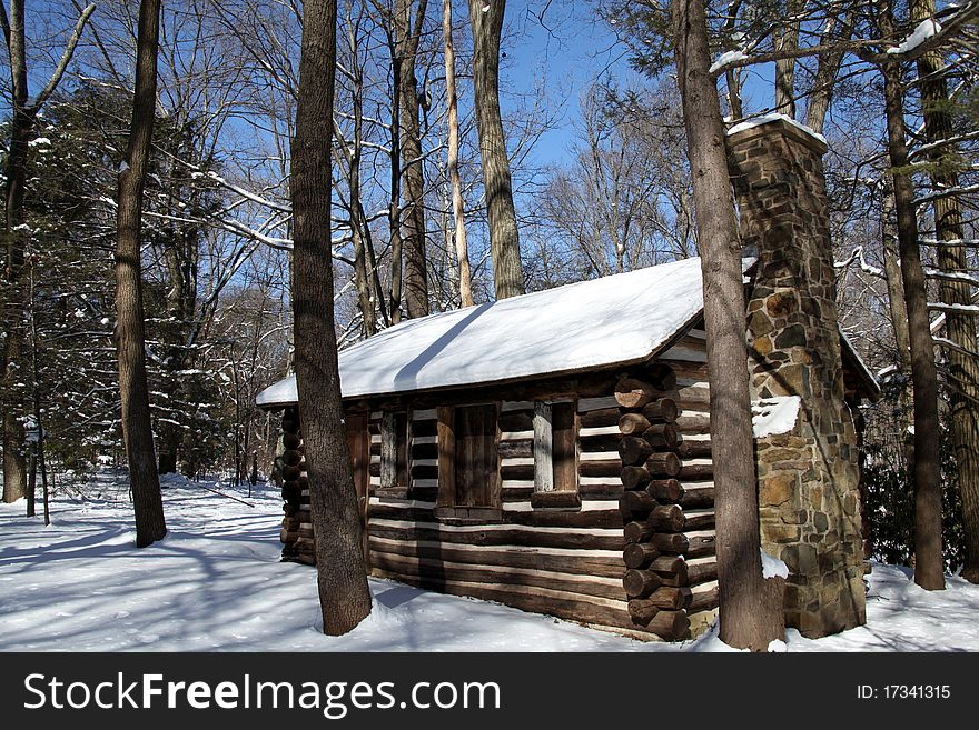 Colonial Log Cabin in Snow