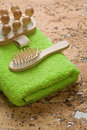 Free Massager And Hairbrush On Green Towel Royalty Free Stock Photos - 17350348