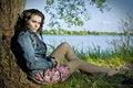 Free Beautiful Young Woman Relaxing Near River Royalty Free Stock Photo - 17355425