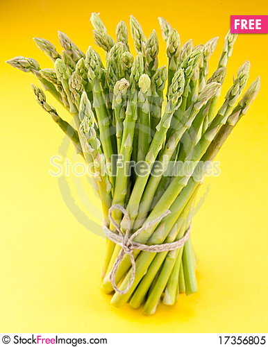 Free Sheaf Of Asparagus On A Yellow. Royalty Free Stock Photo - 17356805