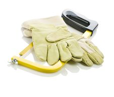 Gloves On Hacksaw Stock Images